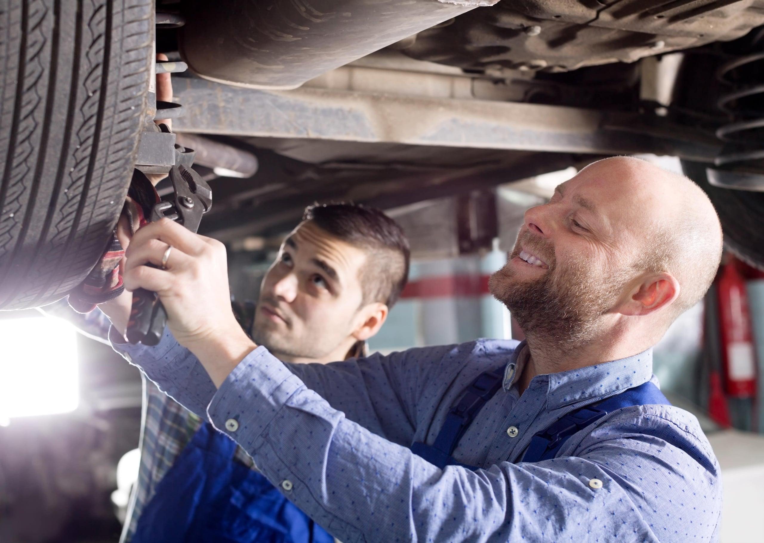 Master mechanics under the car